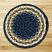 Round Light Blue, Dark Blue, and Mustard Braided Jute Rug, by Capitol Earth Rugs.
